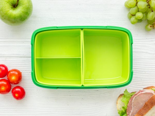 breakfast take away with lunchbox and fresh food on white wooden table background top view